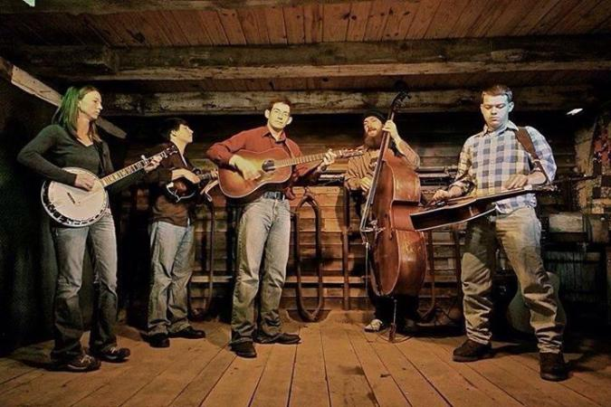 Bud's Collective: Gina Clowes on banjo, Jack Dunlap on mandolin, Buddy Dunlap on guitar, Cody Brown on bass, and Gaven Largent on dobro.